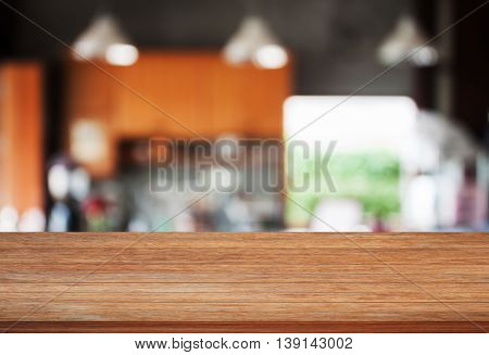 Top wooden with abstract blur coffee shop background, stock photo