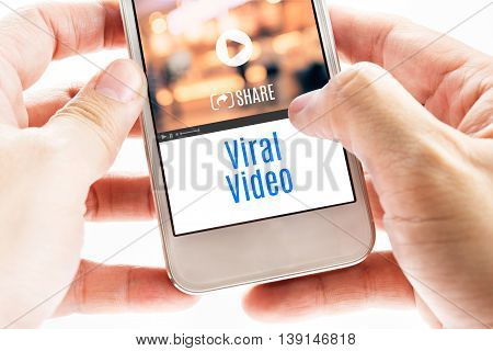 Close Up Two Hand Holding Smart Phone With Viral Video Word And Icons, Digital Concept