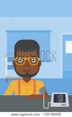 An african-american man taking care of his health and checking his blood pressure with digital meter. Vector flat design illustration. Vertical layout.