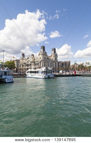 BARCELONA SPAIN - MAY 11 2016 : View from the sea on Port Vell and Barcelona's old Customs building Barcelona Spain.It is a waterfront harbor in city and part of the Port of Barcelona.16 million people visit the complex each year