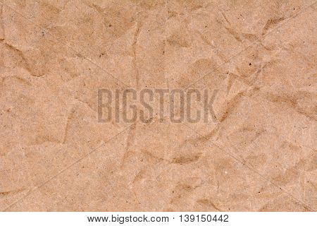 Old crumpled fibrous paper texture background, close up