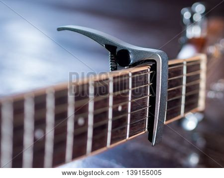 Guitar Capo on Third Fret of Guitar Neck, close up shote