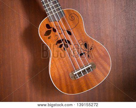 close up of hawaii ukulele flower sound hole