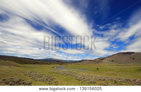 View of Slough Creek under cirrus cloudscape in the Lamar Valley of Yellowstone National Park