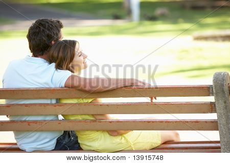 Couple Sitting Together On Park Bench