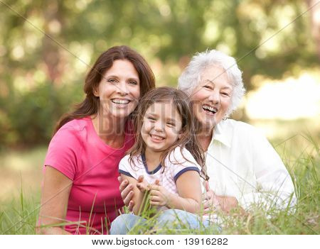 Grandmother With Daughter And Granddaughter In Park