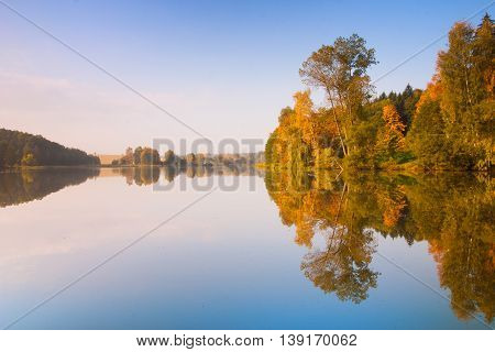 Symmetry - autumn morning on the lake