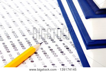 Filled answer sheet with eraser focus on pencil