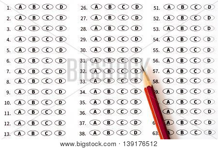Test score sheet with answers and pencil. Education concept