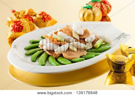 Sensations sauteed mashed cuttlefish with sugar peas fungus
