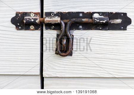 latch door on wooden siding fiber cement board