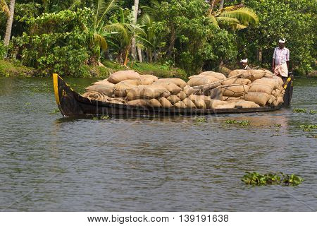 Allepey Kerala India March 31 2015: Indian man transport dwell on boats. Backwaters canoe