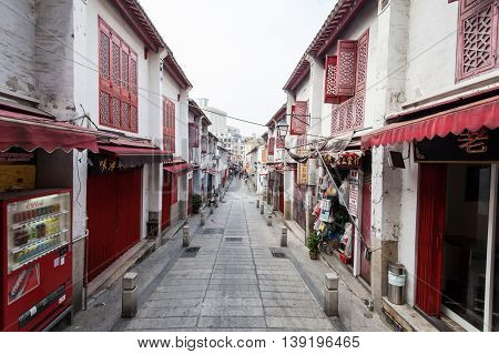 Senado, Macau - February 3, 2015: Rua da Felicidade is a street in Macau that has buildings and street painted in red and  was once the heart of Macau's red lights district.
