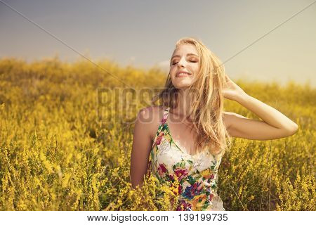 Blonde  Young Beautiful Girl In The Field Photo