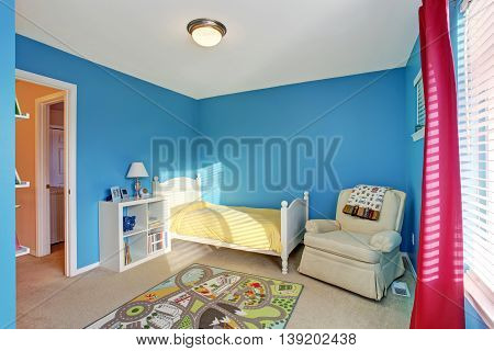 Cute Kids Room With Blue Walls And Carpet.