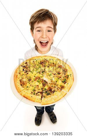 A boy is happy to eat pizza. Fast food. Italian food. Isolated over white.