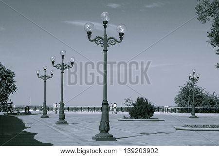 Streetlamps in city park. Walking in park