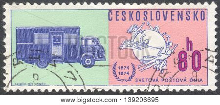 MOSCOW RUSSIA - CIRCA JANUARY 2016: a post stamp printed in CZECHOSLOVAKIA shows Postal Union Emblem & Early mail truck the series