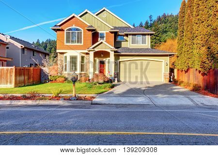 Classic House With Garage, Driveway, And Grassy Front Yard.