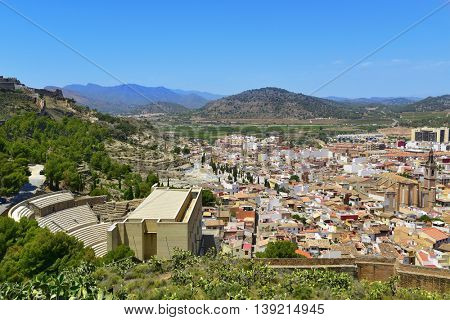 an aerial view of Sagunto, Spain, highlighting the ancient roman theater to the left and the Iglesia de Santa Maria church to the right