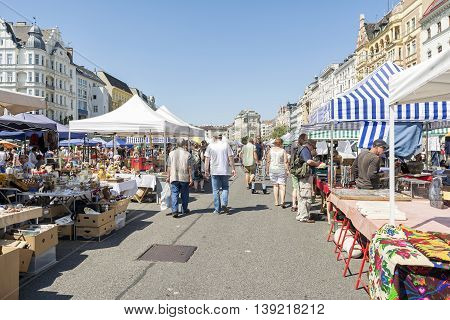 VIENNA, AUSTRIA, JULY 2,2016: People walking at the end of Naschmarkt, a popular and big fleamarket only open on saturdays.