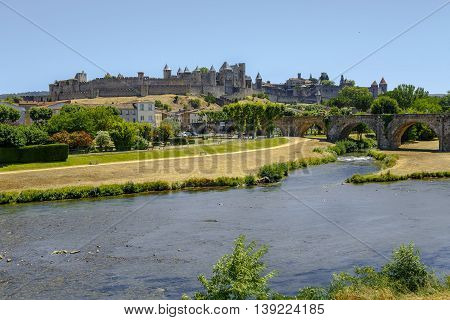 Carcassonne - France July 17 2016: Castle of Carcassonne and Pont Vieux bridge in southern France