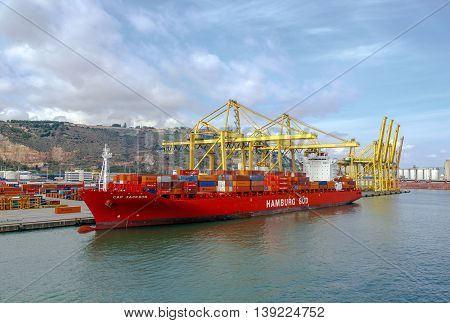 Barcelona Spain - September 26 2015: A container ships are standing in Barcelona port. It is Catalonia's largest port with a trade volume of 2.57 million TEU's.