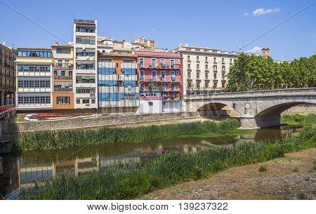 GIRONA SPAIN - JULY 6 2016: Colorful houses against blue sky in Girona Catalonia Spain