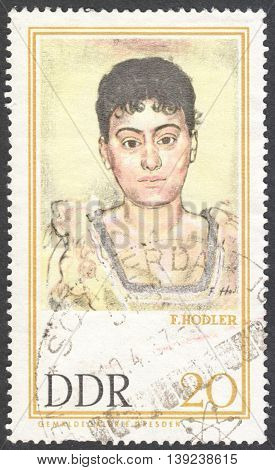 MOSCOW RUSSIA - CIRCA JANUARY 2016: a stamp printed in DDR shows Portrait of Madame de R. by Ferdinand Hodler the series