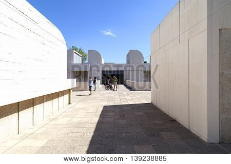 BARCELONA SPAIN - MAY 12 2016 :Tourists on the terrace of the building Joan Miro Foundation in a sunny day. Joan Miro Foundation Centre of Studies of Contemporary Art is a museum of modern art located on the hill Montjuïc .It was founded in 1968.