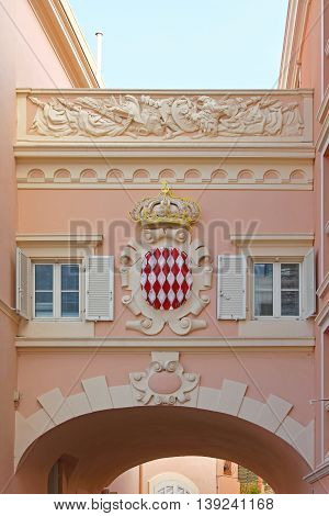 MONACO CITY MONACO - JANUARY 18: Principality of Monaco Coat of Arms in Monaco on JANUARY 18 2012. Shield of Principality of Monaco at Bridge in Monaco City Monaco.