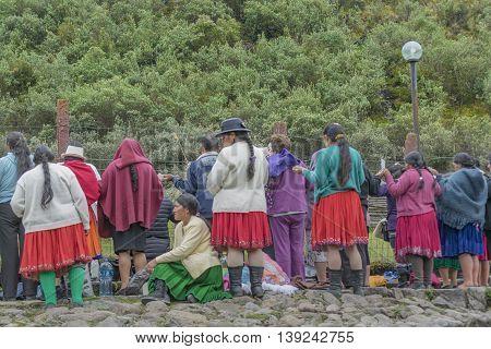 CUENCA, ECUADOR, OCTOBER - 2015 - Group of native ecuadorian catholic indigenous praying at outdoors in Cuenca outskirts Ecuador South America