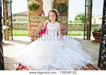 Portrait Of Cute Little Girl On White Dress And Wreath Of First Holy Communion Background Monument O
