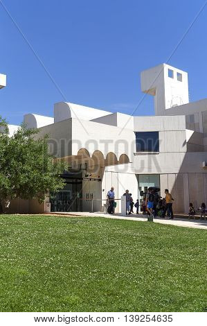 BARCELONA SPAIN - MAY 12 2016 :Tourists in front of the building Joan Miro Foundation . Joan Miro Foundation Centre of Studies of Contemporary Art is a museum of modern art located on the hill Montjuic .It was founded in 1968.