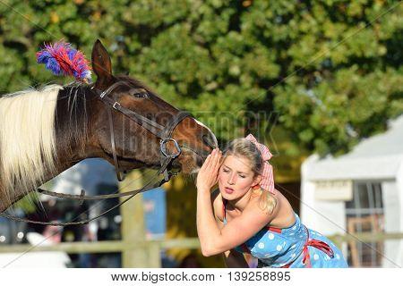 IPSWICH SUFFOLK UK 25 October 2014: East Anglia Equestrian Fair girl listening to talking horse