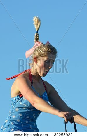 IPSWICH SUFFOLK UK 25 October 2014: East Anglia Equestrian Fair Horse gymnastic woman with flying ponytail