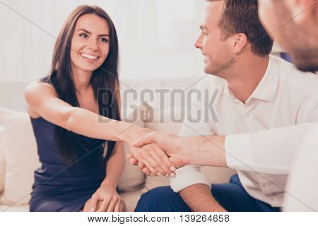 Young Smiling Woman In Formalwear Handshake With Business Partner