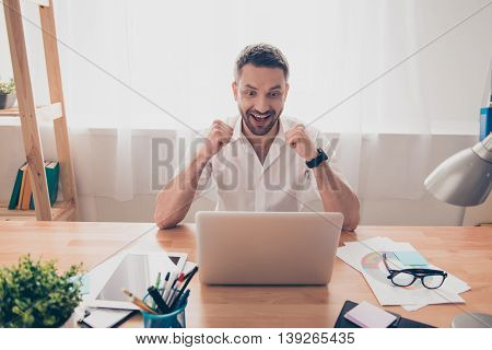 Happy Businessman Achiving His Goal And Showing Fists