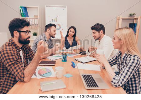 Young Managers Conversing At Conference Table, They Planning New Project