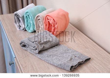 Stack of clothes on table