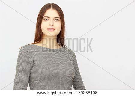 Advertising. Young succesful businesswoman.Woman in dress show copyspace