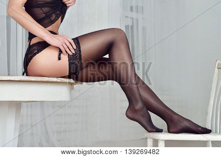 Beautiful Sexy Lady In Elegant Black Panties And Stockings. Close Up Fashion Portrait Of Model Indoo