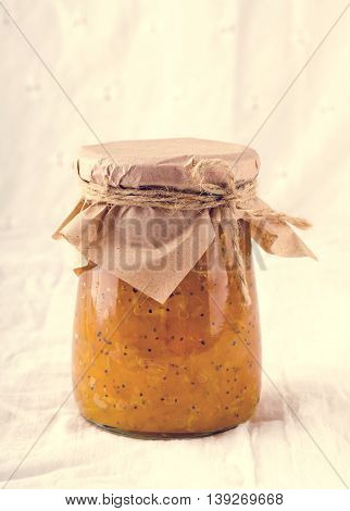 Pumpkin-Orange-Ginger-Poppy seed homemade jam on white background.