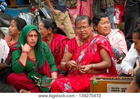 BHAKTAPUR NEPAL - APR 05: Unidentified musicians performing live music on the street on Apr 05 2014 in Bhaktapur Nepal.