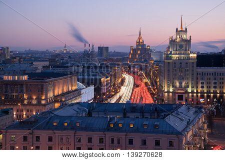 Garden ring, Theatre of Satire, Stalin skyscraper on Kudrinskaya Square at evening, long exposure