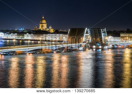 Diluted Palace Bridge, St. Isaac Cathedral at night in St. Petersburg, Russia