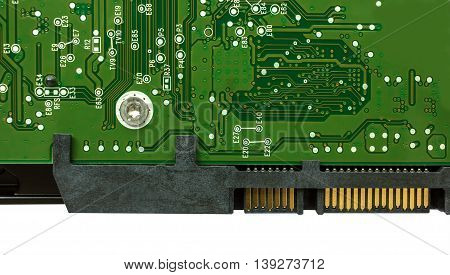 computer hard drive with printed motherboard and microcircuit close-up