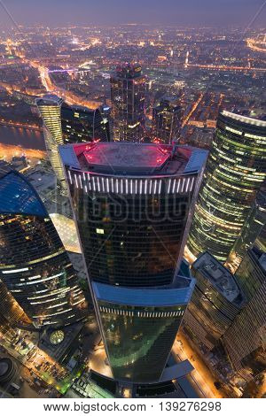 MOSCOW, RUSSIA - OCT 17, 2015: Eurasia Tower in Moscow City business complex at night. Eurasia Tower - 309-meter high building with total area of 207,542 square meters