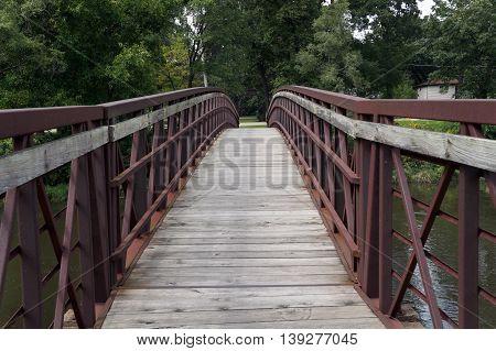 Pedestrians may cross the Du Page River via the David A. Barry Pedestrian Bridge in Shorewood, Illinois.