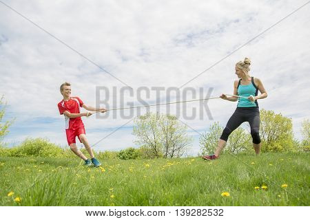 A Mother and Son Tug of War outside